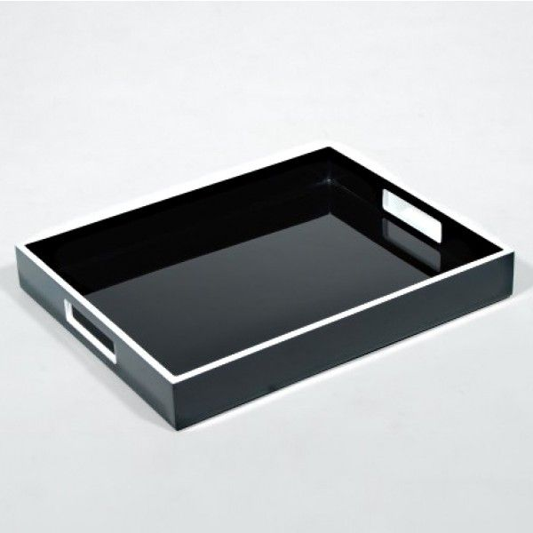 Black Breakfast Tray Founded with the objective to provide the highest quality lacquer finished home accessories, this exquisite artisan is based in San Francisco. This distinctive tray has felt feet and convenient handles. Featuring clean white accents, the smooth high gloss finish adds an element of refinery. Great for serving drinks and meals.