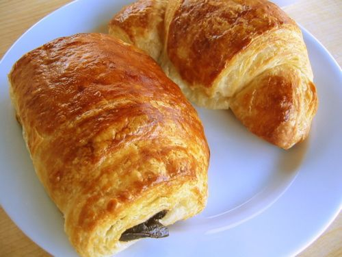 Pain Au Chocolat - with step by step instructions.  I've tried this recipe and was astounded I managed to make something in my oven that was as good as any professional ones I've eaten.  This web site is chock full of recipes for every kind of pastry/dessert you can fathom.