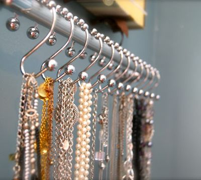 Shower curtain hooks for jewelry, belts, scarves.  Under shelves?