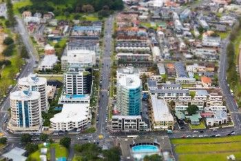 Beachside buildings of Mount Maunganui as seen from the top of Mauao, Bay of Plenty, New Zealand. - Buy this print