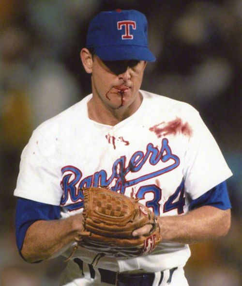 Nolan Ryan — took a hard come-backer here from Bo Jackson in the mouth.