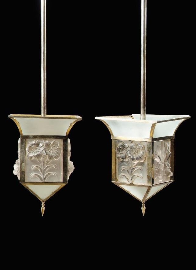 René Lalique A PAIR OF GLASS AND SILVERED METAL LANTERNS each cylindrical stem above a square lantern with four foliate deep relief cast side panels, with Breves Gallery mounts and later upper frosted glass panels 137cm. high; Lalique panels: 19.5cm. high by 17.5cm. wide; 4ft. 6in., 7 3/4 in., 7in. circa 1930