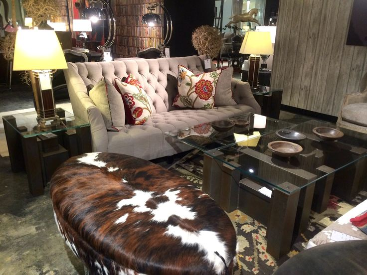 Shown is our Columbus Coffee Table, Columbus Side Table and Rochester Sofa. #furniture #andrewmartin #interiordesign #decor #hide #tufted #unique #neutral #pattern #wallpaper