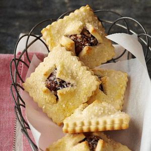 Italian Fig Bundles.  Italian Fig Pockets  Dried fruits flavored with orange zest fill these soft cookie pockets. A star-shaped cookie cutter and coarse sugar dresses them up.