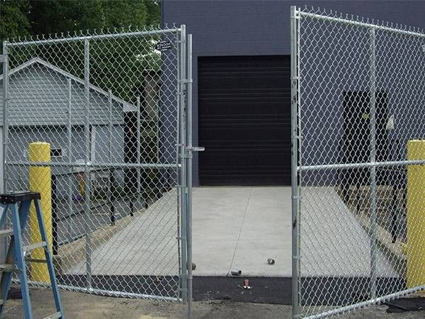 A Temporary Chain Link Fence Panel With Double Swing Gate For