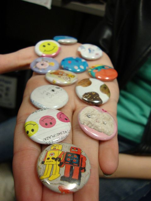 """Teens love our Button Maker. It's one of our most popular """"passive programs."""" Save some old magazines, set up the the button maker (we got ours from American Button Machines), and occasionally re-up on supplies. A teen volunteer even created step-by-step instructions, with photos!"""