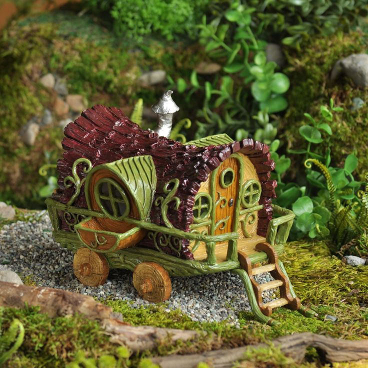 An old gypsy wagon converted into a makeshift home to house a group of traveling fairies. Note: Door does not open.