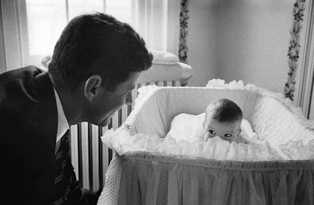This 1958 photo of JFK catches the future president making eyes at his daughter, Caroline Kennedy.