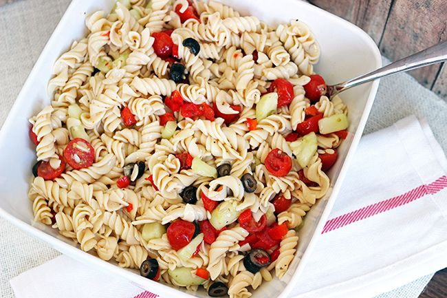 Pasta Salad - Perfect for Picnic Season! As spring starts to push away the blustery cold, we start dreaming of picnics - and pasta salad! This one is colorful and tasty! We bumped up the vegetables (6 cups for the whole recipe) to boost nutrition. One 12 ounce box of pasta + 6 cups of vegetable makes 24 (1/2 cup) portions. 1 portion = 1/2 bread/grain serving + 1/4 cup vegetable.