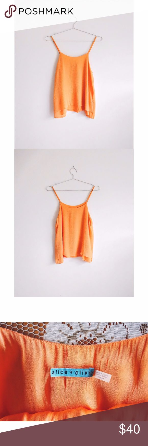 "Alice + Olivia Tangerine Orange Silk Cami Top sz M Alice + Olivia Melon Tangerine Orange Silk Cami Blouse size Medium, gently used--no rips, stains, or holes, style# R205008687, scoop neck, adjustable spaghetti straps, floaty silhouette, neon tangerine soft orange crinkled silk georgette layered over match stretch silk lining, 100% silk, lining 94% silk, 6% spandex, ~18"" pit to pit, 16"" middle of neckline to hem Alice + Olivia Tops Blouses"