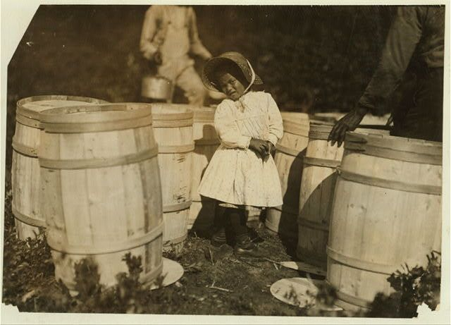 Mary Christmas, nearly 4 years old. Picks cranberries sometimes. She is now picking up berries spilled at the barrels by Grandfather.