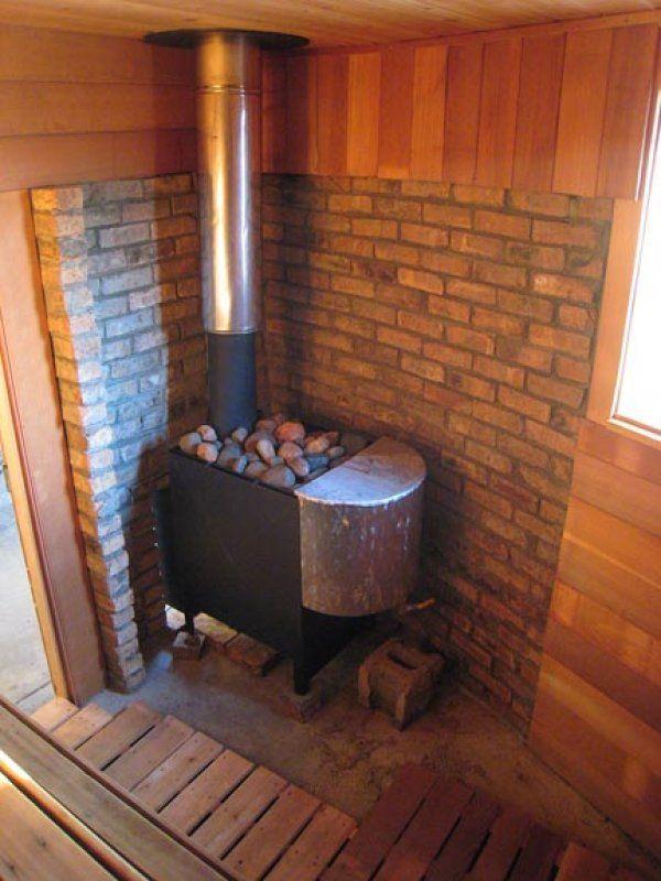 Here's a charming sauna stove in the corner of a DIY sauna.