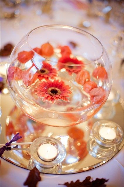 fish bowl decoration for wedding day with roses and ornaments