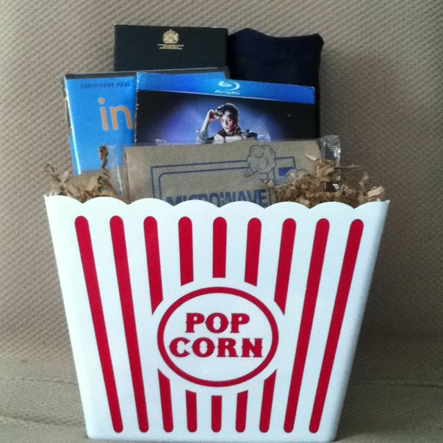Birthday present for boyfriend: two favorite movies (Im Juli & Back to the Future), t-shirt (Hill Valley High), top shelf liquor (scotch), packs of microwave pop corn.