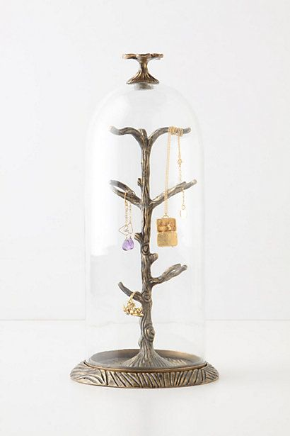 I like how this makes jewelry look like museum pieces. Neato! Cloche jewelry stand.