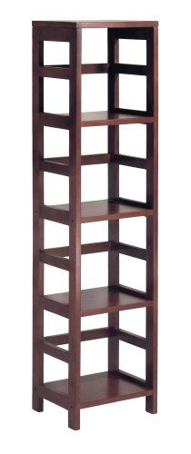 Part of Winsome Wood's modular shelving unit collection, this narrow four-shelf model features a tall profile framed by the line's signature open ladder-style sides and back. The solid/composite-wood construction provides strength and durability, while the rich Espresso finish adds a warm yet modern feel. Matching wicker storage baskets with wire frames are sold separately. Other unit sizes include the two-shelf narrow, two-shelf wide, and three-shelf wide. This version measures 13.5 inches…