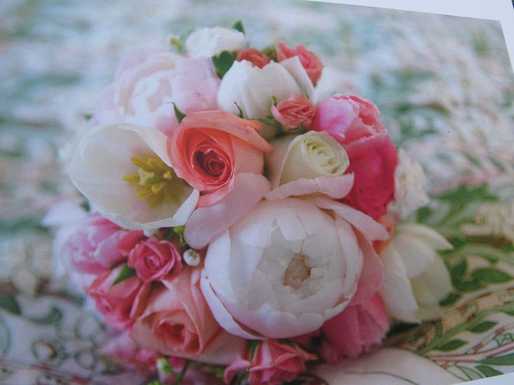 I loved my bouquet. It had peonies, roses, tulips and dianthus flowers (and one lily of the valley) in the shades of white and pink.
