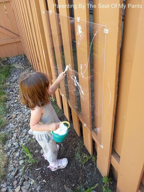 Shaving cream painting outside on plexi glass. Great for sensory play too....  I remember my K teacher having an A frame in her room with plexi glass she would put shaving cream on. One of the very few things I can remember from kindergarten