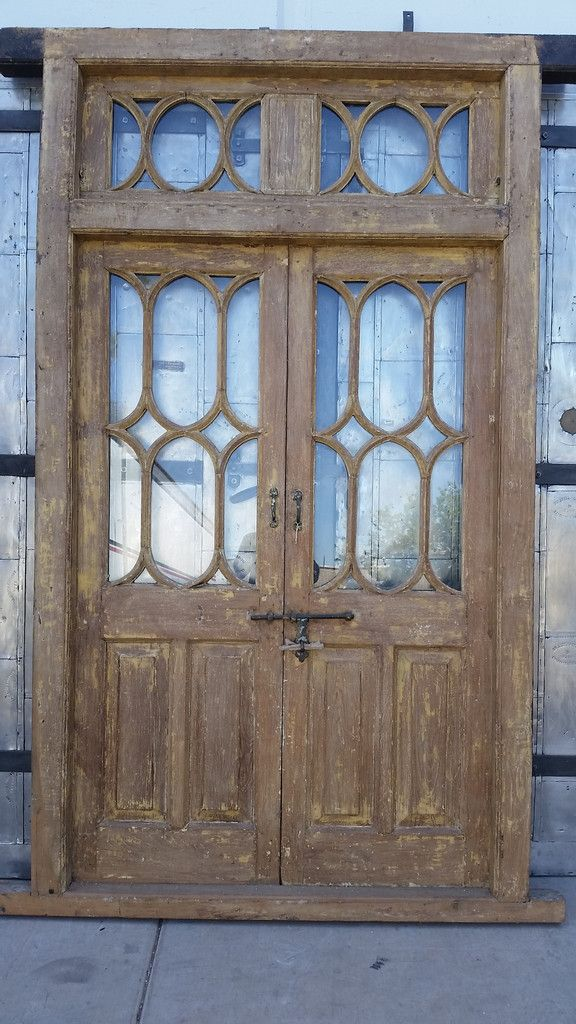 Doors with Oval Glass Panes and Transom