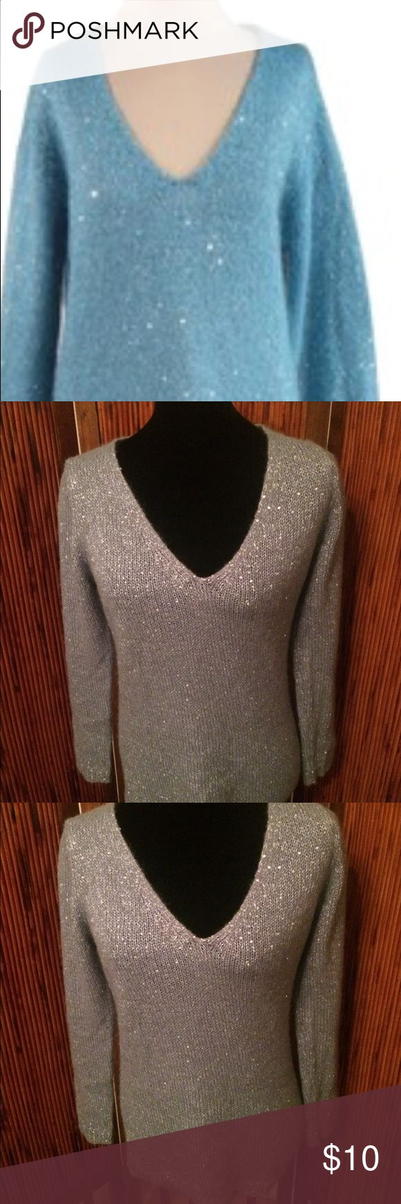 Joe Fresh Light Blue Sequined V-Neck Sweater SP Joe Fresh Light Blue Sequined V-Neck Sweater Size Small Petite. In good used condition. No stains, rips, or holes. There are 2 fabric pulls on the front of the sweater and they are shown up close in the pics. The materials tag has been removed. Comes from a smoke and pet free home. Thanks for looking 😊 Joe Fresh Sweaters V-Necks