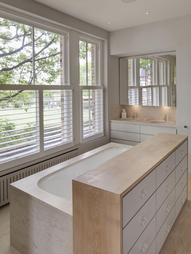 I love the partition and tub away from the windows. Hurlingham Road slide image 6