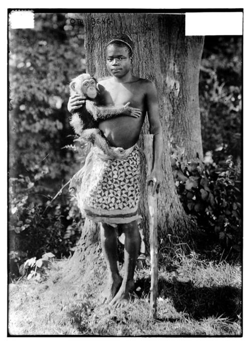 """1906 photograph of Ota Benga, described as being taken at Bronx Zoo.  """"In 1906 at the age of 23, 43 years after slavery was abolished he was unveiled in a new exhibit that would attract legions of visitors at the Bronx Zoo in New York. He was put on display in the monkey house and it's estimated that 40,000 visitors a day came to see him...""""  Read more here: http://www.npr.org/templates/story/story.php?storyId=5787947  Credit: Bain News Service, publisher"""