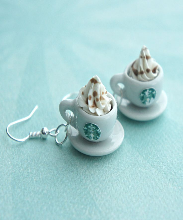 these earrings feature a pair of miniature Starbucks coffee topped with whipped cream. each miniature coffee cup measures 1.2 cm in diameter and is securely attached to a silver tone hook.