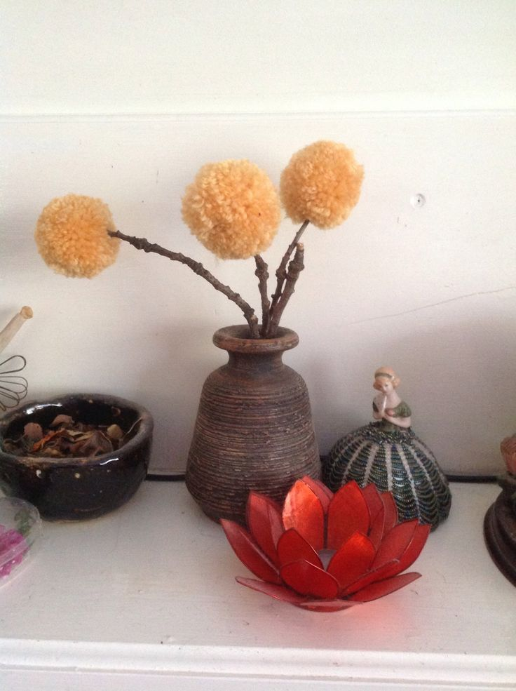 Pom Pom flowers made with wool and oak twigs. Reminds me of billy buttons that grow on the side of the roads.