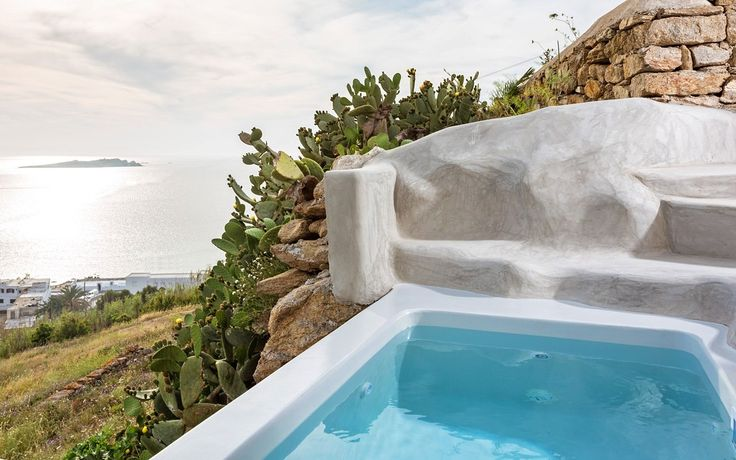 The Bohemian Sea View Suite of the Boheme Mykonos Hotel is the perfect choice for a Sea view suite in Mykonos Town. A/C, double bed, jacuzzi, terrace & more