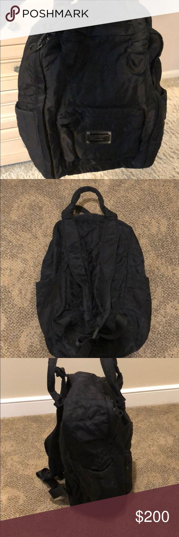 Marc Jacobs black stylish backpack Lightly used Marc Jacobs backpack. Lots of space and two side pouches. Black subtle stitching with the brand name. No dirt or pulls. Marc Jacobs Bags Backpacks