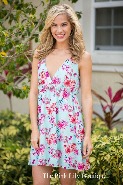 The first time you lay eyes on this floral dress, you're going to fall in love! It features a v-neck in the front and the back and an elastic band around the waist! Pair it with wedges for a darling look