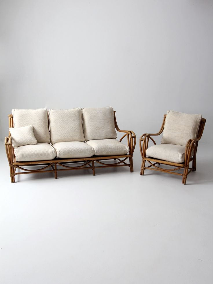 A vintage rattan furniture set circa 1940s. The bentwood rattan set features a full size couch and arm chair. They have cushion backs and seats with the original covers. - rattan furniture set - couch