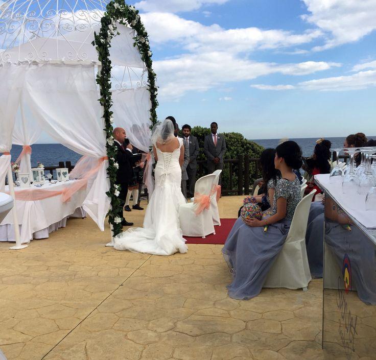 Wedding ceremony at Sunset Beach Club.
