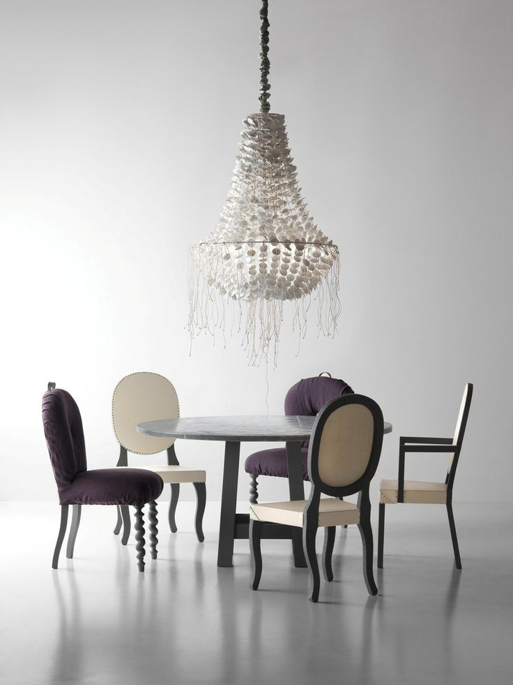 Love the simplicity of the different chairs and the impact of the chandelier
