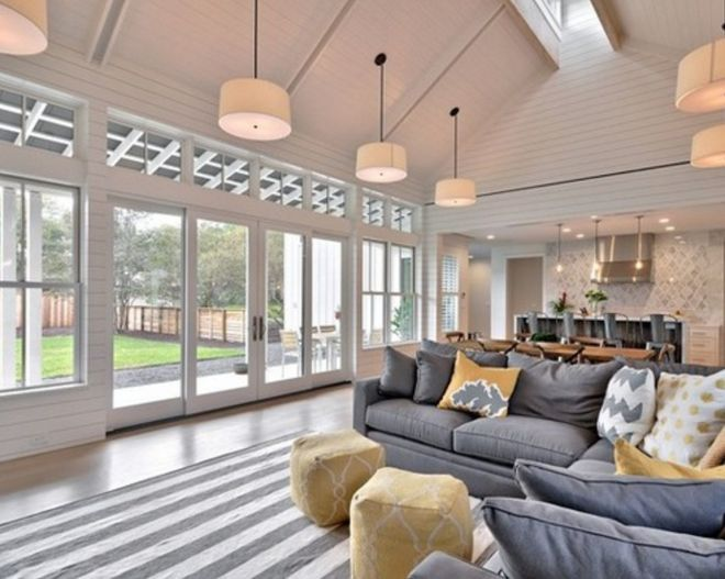 This home, dubbed the 'Modern Farmhouse' on its designer's website, keeps the traditional Farmhouse properties like the large porch and pointed rooftops, but adds in an entirely modern design twist...