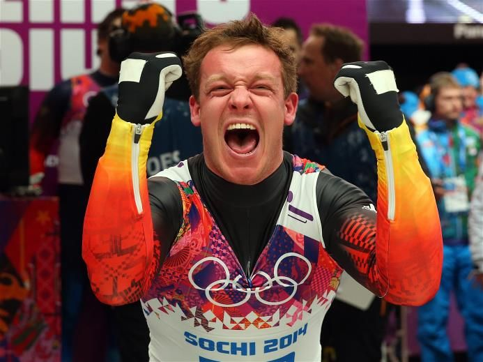 Sochi 2014 Day 3 - Luge Men's Singles Felix Loch of Germany celebrates winning the gold medal during the Men's Luge Singles