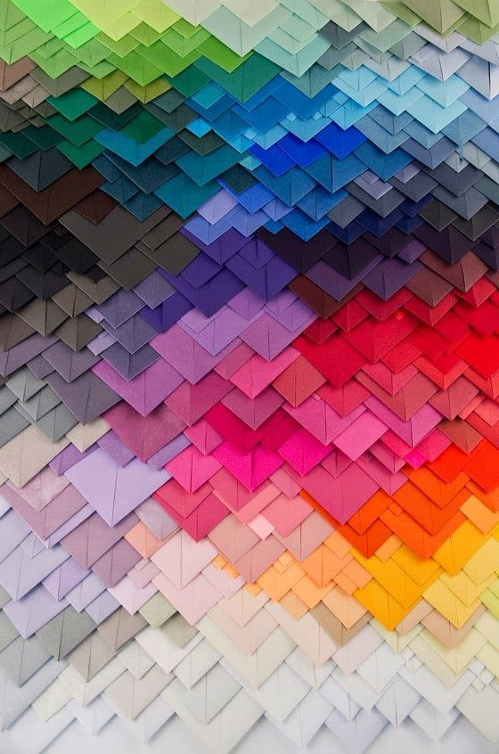 Beautiful colour gradient of folded paper. #WilliamHannahUK #paperfolding #papersquares #folds #colour #journal #writing #possibilitiesofpaper www.williamhannah.com
