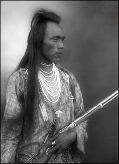 """Nicoli (also known as """"Pix-on-che-la-hoit) a Salish man on the Flathead Indian Reservation in western Montana. Photo  c1905."""