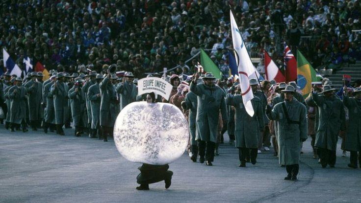Albertville, 1992 Unified Team flag bearer Valery Medvedtsev leading the delegation consisting of Russia, Ukraine, Kazakhstan, Belarus, Uzbekistan, and Armenia during athlete procession at Theatre des Ceremonies.