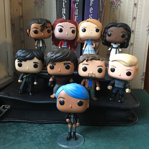 If you are looking for these press the visit link under the photo to the creator's etsy account!  The Lunar Chronicles Funko POP Vinyl Customized Various