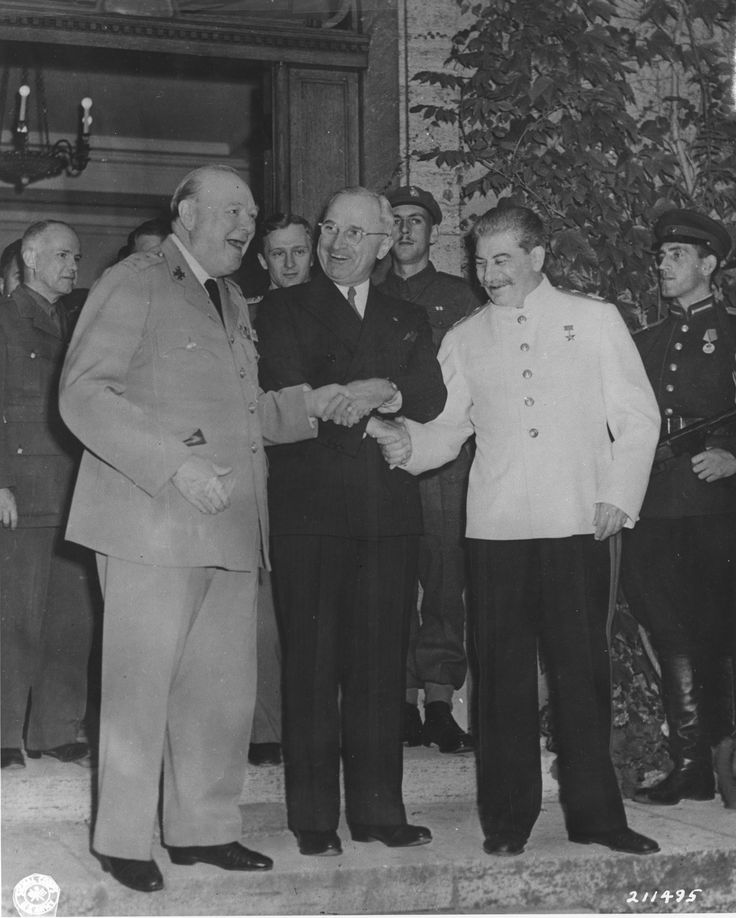 Churchill, Truman, and Stalin shaking hands during the Potsdam Conference, Germany, 23 Jul 1945, photo 2 of 3 potsdam23.jpg (2266×2827)
