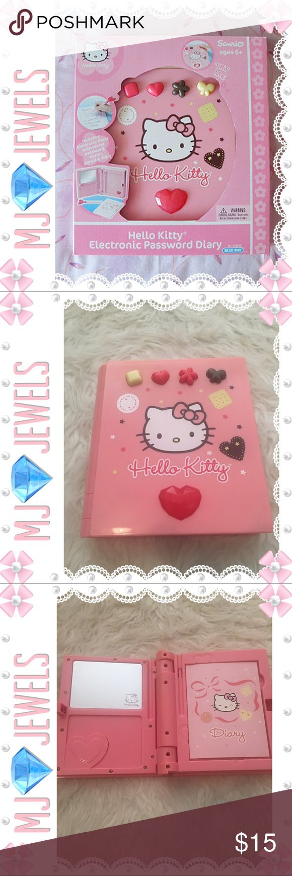 "Hello Kitty Electronic Diary Psst! Can you keep a secret? Hello Kitty can! With this Electronic Password Diary, she'll keep all your hopes and dreams under wraps. You'll need a secret password just to get in, which means the diary is for your eyes only. Includes a mirror, pencil and diary. Requires 2 ""AA"", included. Measures 8"" x 6.5"". Not New In Good Condition2""AA"" included Does not have original box ‍♀️ Hello Kitty Accessories"