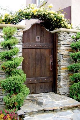 Rustic Landscape/Yard with Garden Passages Designer Wood Gates, exterior stone floors, Pathway, Stacked stone wall, Barn door