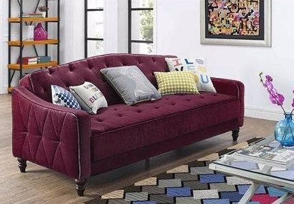 This purple velour fold-down sleeper that has a bold vintage appeal. | 22 Cheap Sofas That Look Like A Million Bucks