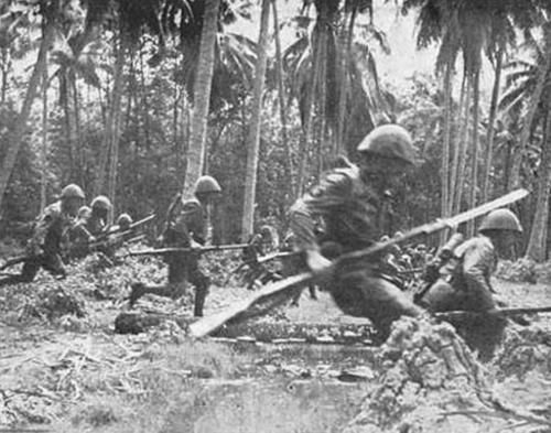 japanese soldiers of the special naval landing force assaulting the jungles of the dutch east indies (january 1942)