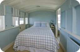 Seabank - East Beach Road, Selsey, West Sussex. This quirky holiday cottage is built around two vintage railway carriages, and is right on the seafront.