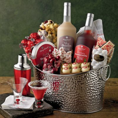 Holiday Cocktail Mixers - $129.95 This stunning cocktail mixer set has everything you need for a sophisticated holiday party. Nestled in a large stainless steel container are gourmet home bar essentials, stemless martini glasses, a full-size cocktail shaker, flavored martini mixers, a variety of peppermint and chocolate sweets to enjoy with your drinks, and more. Share this red- and silver-themed cocktail gift set and make a big impression this holiday season.:
