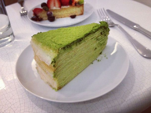 Lady M: Green Tea Mille Crêpe ($8). Count the layers if you dare, there's at least twenty of those lacy, golden crêpes, each separated by a brush of barely whipped cream. The cream is infused with green tea, subtle with a clean finish, the top layer outfitted with a dusting of matcha.