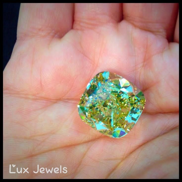 Holly @$#%! Talk about a rare opportunity! 25.85 carat flawless fancy yellow diamond in my hand!!! www.luxjewels.com