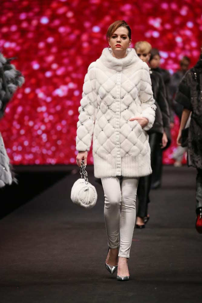 BROADWAY, Fall 2016 Entitled 'Rockuture', this eccentric collection epitomizes the inseparable connection of fashion and music. Quilted leather, lamb with 3-dimensional embossed motif, mink sculpted in geometric shapes, a mix of long and short arctic marble fox and shadow fox, with accent of studs, crystals and zipper, are juxtaposed to recreate the awe and glory of iconic rock stars on stage.